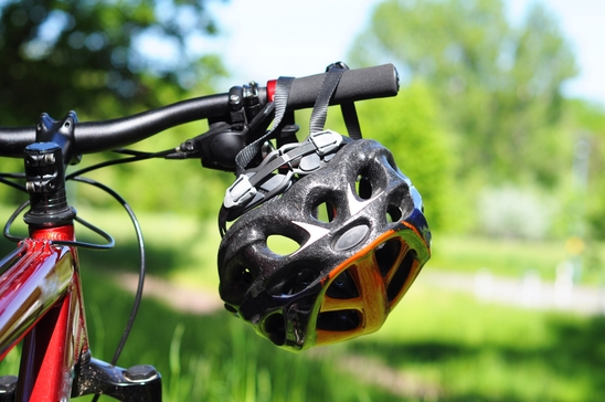 mountain bike with helmet showing safety or sports concept in nature